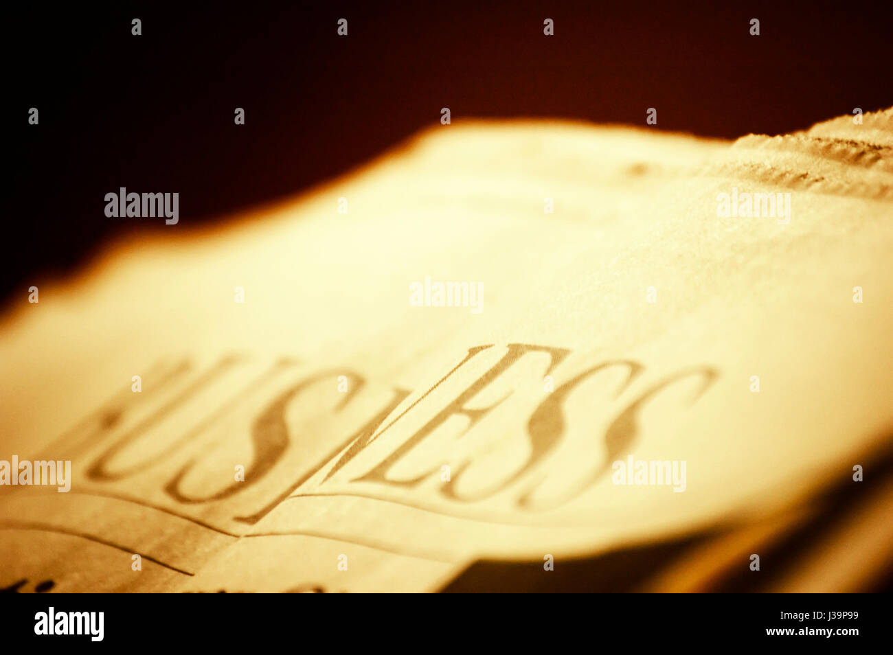 newspaper closeup with Business section headline - Stock Image