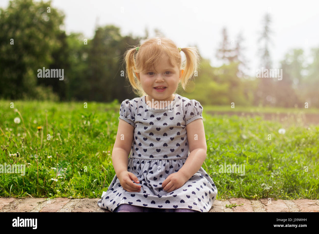 Portrait of a cute toddler girl - Stock Image