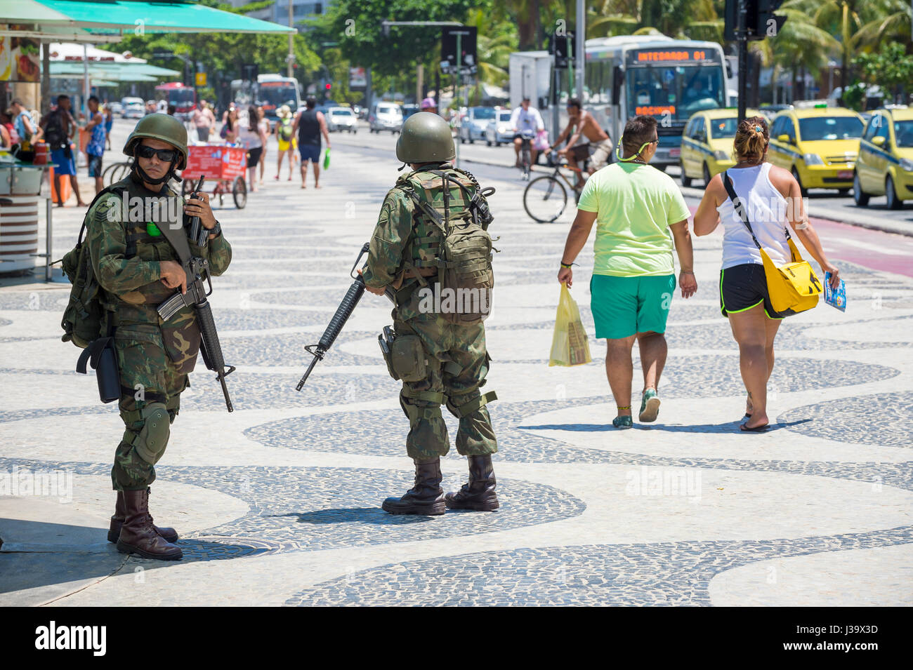 RIO DE JANEIRO - FEBRUARY 10, 2017: Two Brazilian Army soldiers stand in full camouflage uniform on the boardwalk - Stock Image