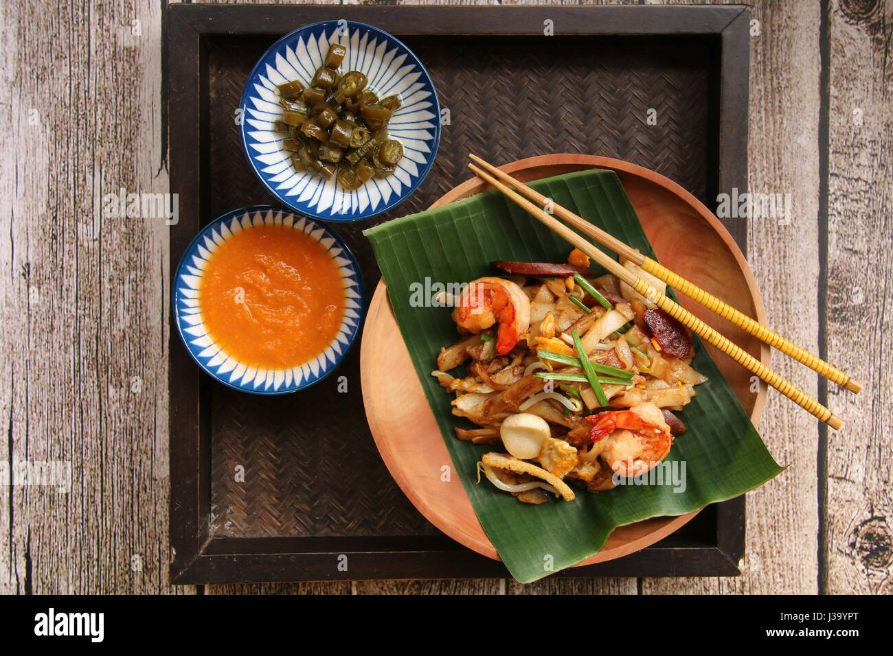 Singapore hawker food stock photos singapore hawker food stock char kway teow stir fried flat rice noodles with shrimps sausage beansprouts forumfinder Images