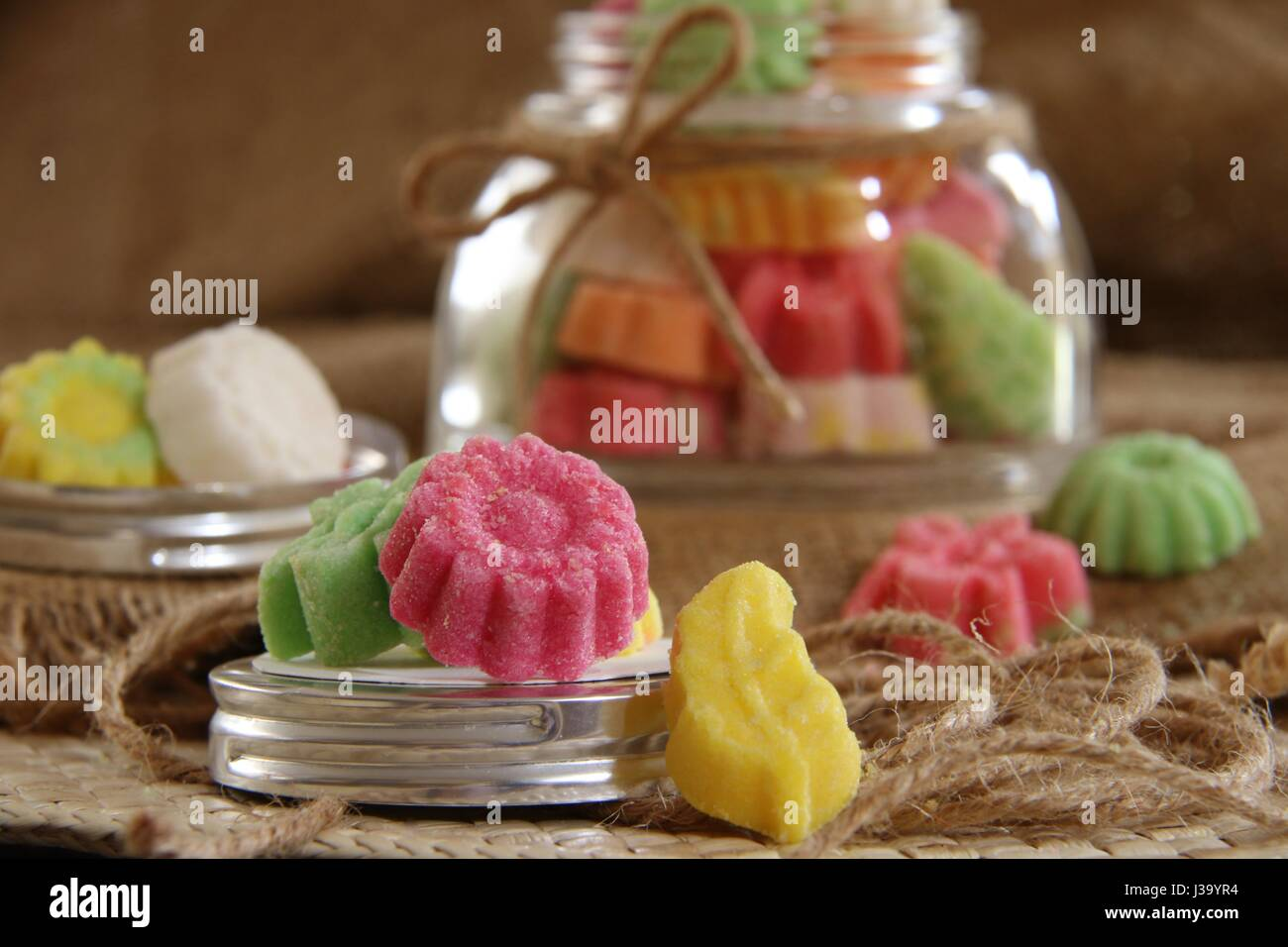 Satru Asem Malang. Citrus candy from Malang, East Java. Stored in a glass jar tied with a ribbon. - Stock Image