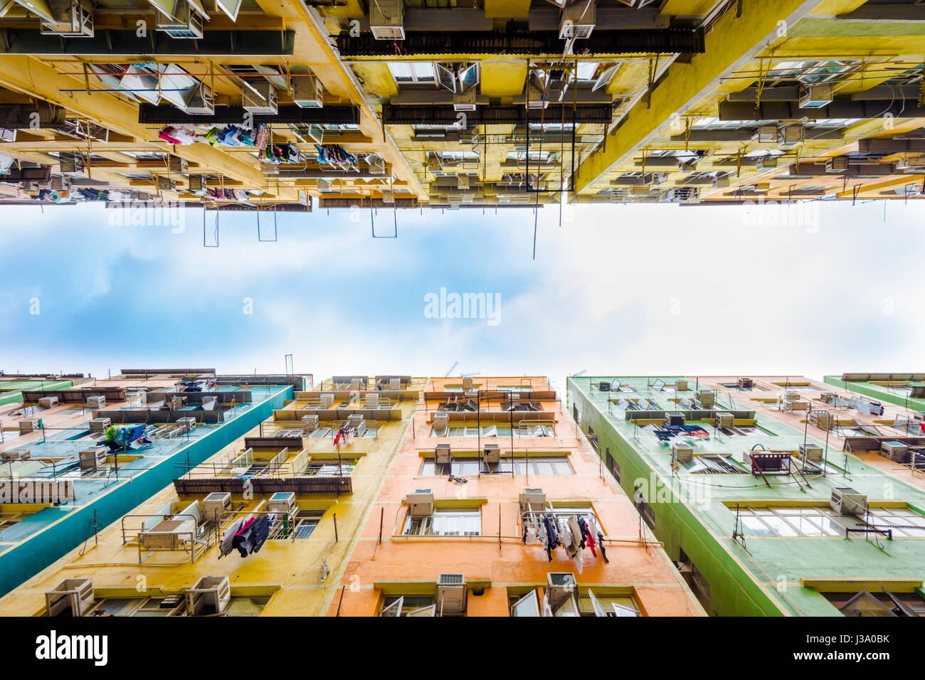 Unusual view from ground to sky through the old style To Kwa Wan residential buildings in Kowloon, old Kai Taki - Stock Image