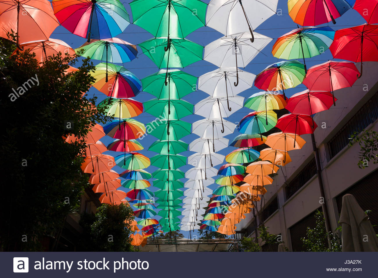 A 'Ceiling' of coloured umbrellas forming a display above an outside cafe in the Turkish quarter,Nicosia, Cyprus Stock Photo