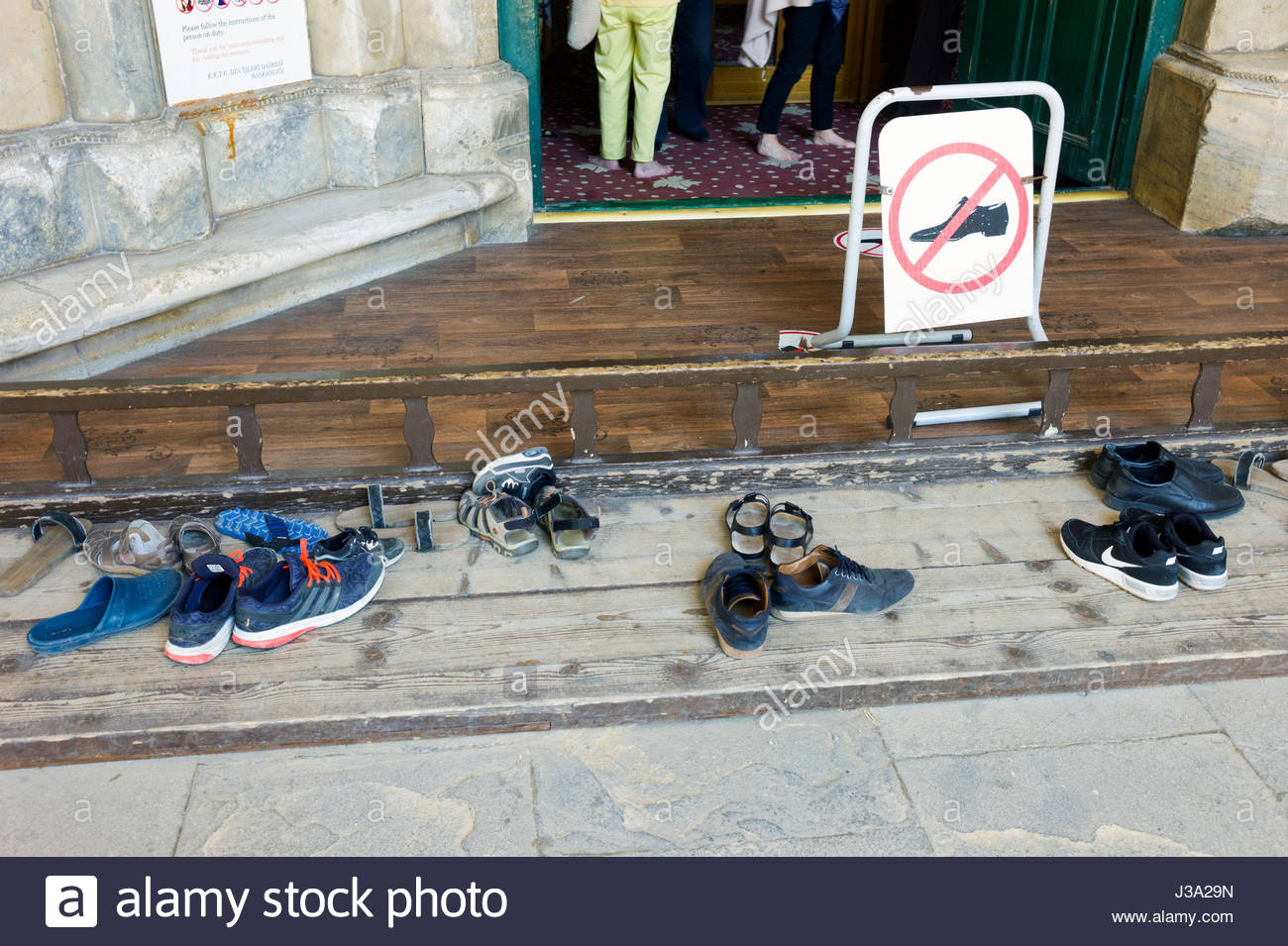 Shoes on the steps outside a mosque in northern Nicosia, Cyprus having been taken off before entering - Stock Image