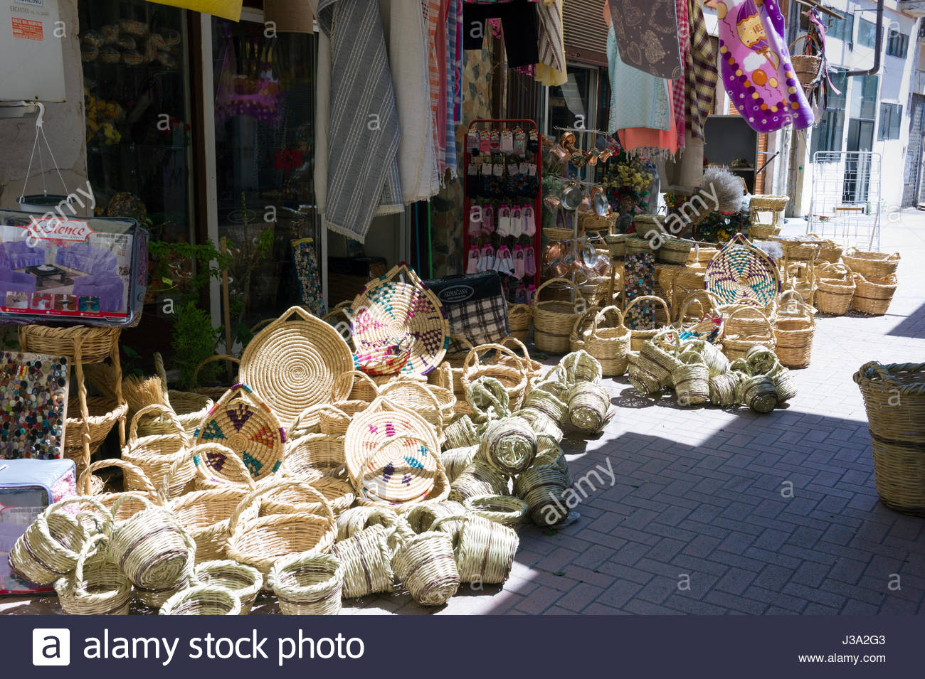 Wicker baskets on sale in a traditional street market in the Turkish quarter, Nicosia, Cyprus - Stock Image