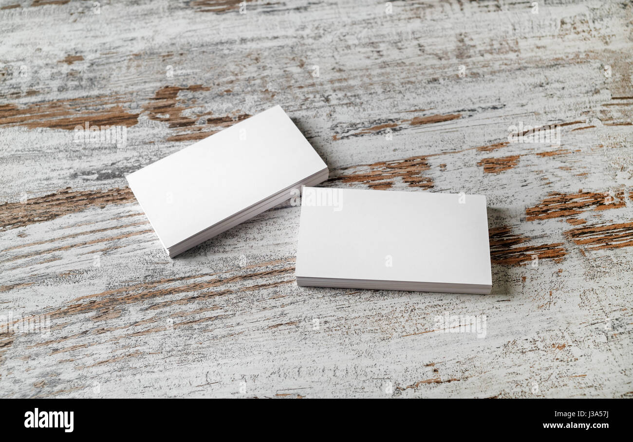 Mockup of two piles of blank horizontal business cards at wooden mockup of two piles of blank horizontal business cards at wooden table background reheart Image collections
