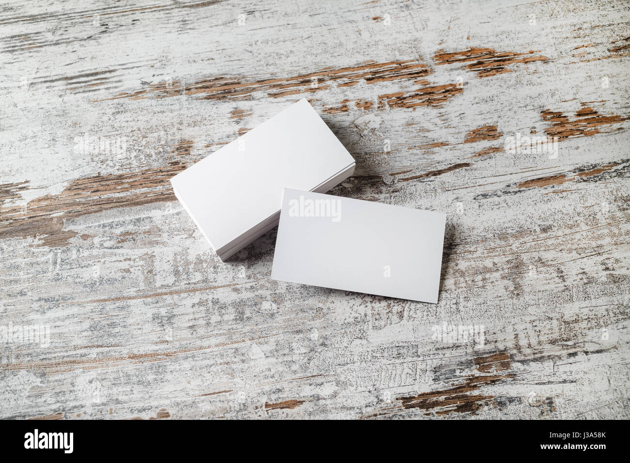 Blank business cards on wood background mockup for branding stock blank business cards on wood background mockup for branding identity stack of blank name cards blank template for design presentations and portfoli reheart Image collections
