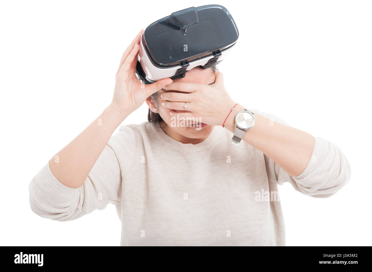 Woman with migraine because intense experince in virtual world with 3d glasses on white background - Stock Image