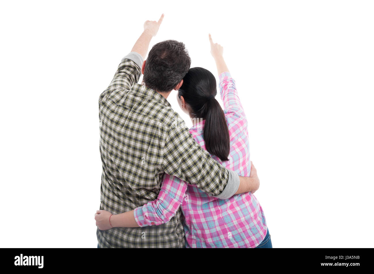 Back view of young couple pointing at something far away isolated on white - Stock Image