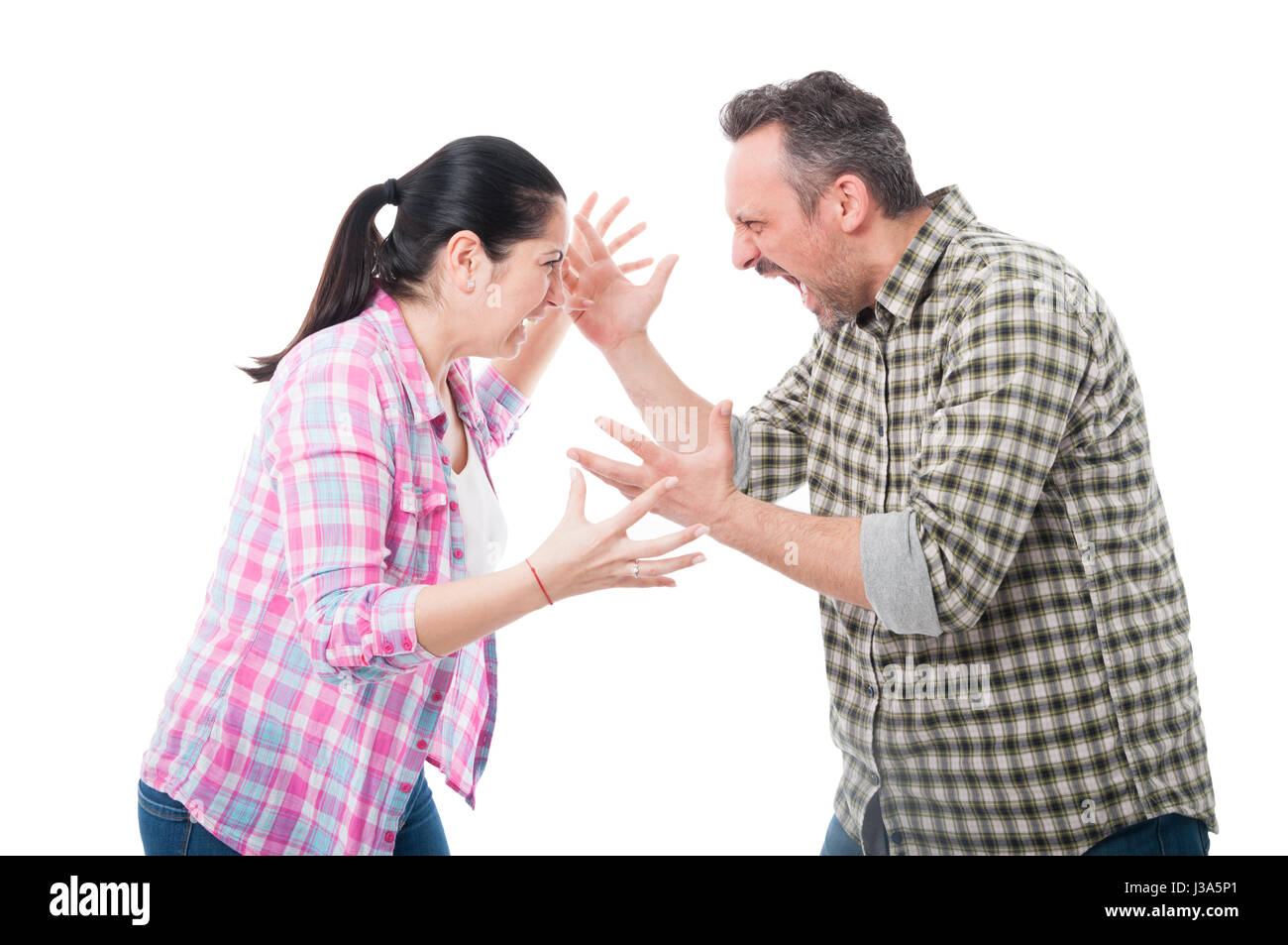 Young couple having an argue and yelling at each other isolated on white background - Stock Image