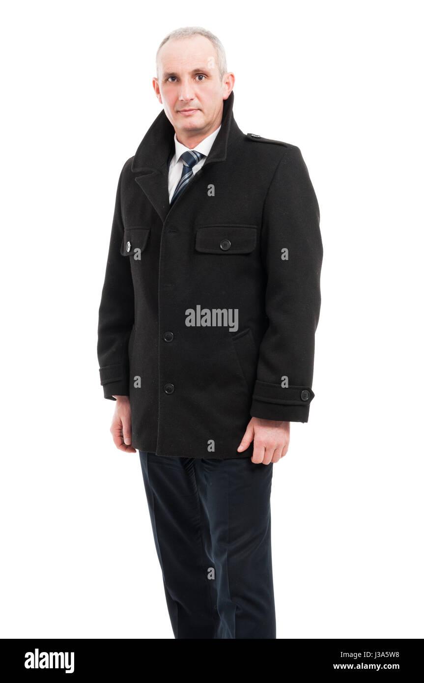 Middle age business man posing wearing overcoat elegant isolated on white background - Stock Image