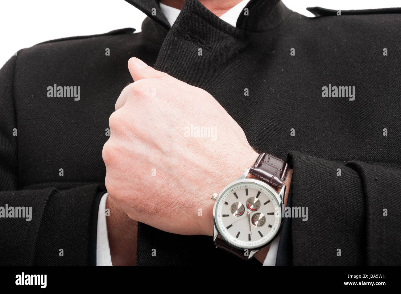 Close-up of  elegant man posing wearing overcoat and watch isolated on white background - Stock Image