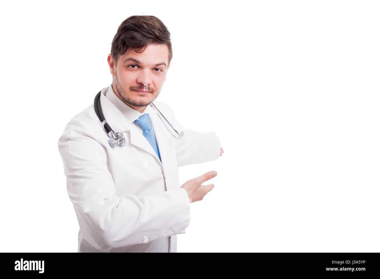 Happy medic in white coat inviting you inside isolated on white background with advertising area - Stock Image