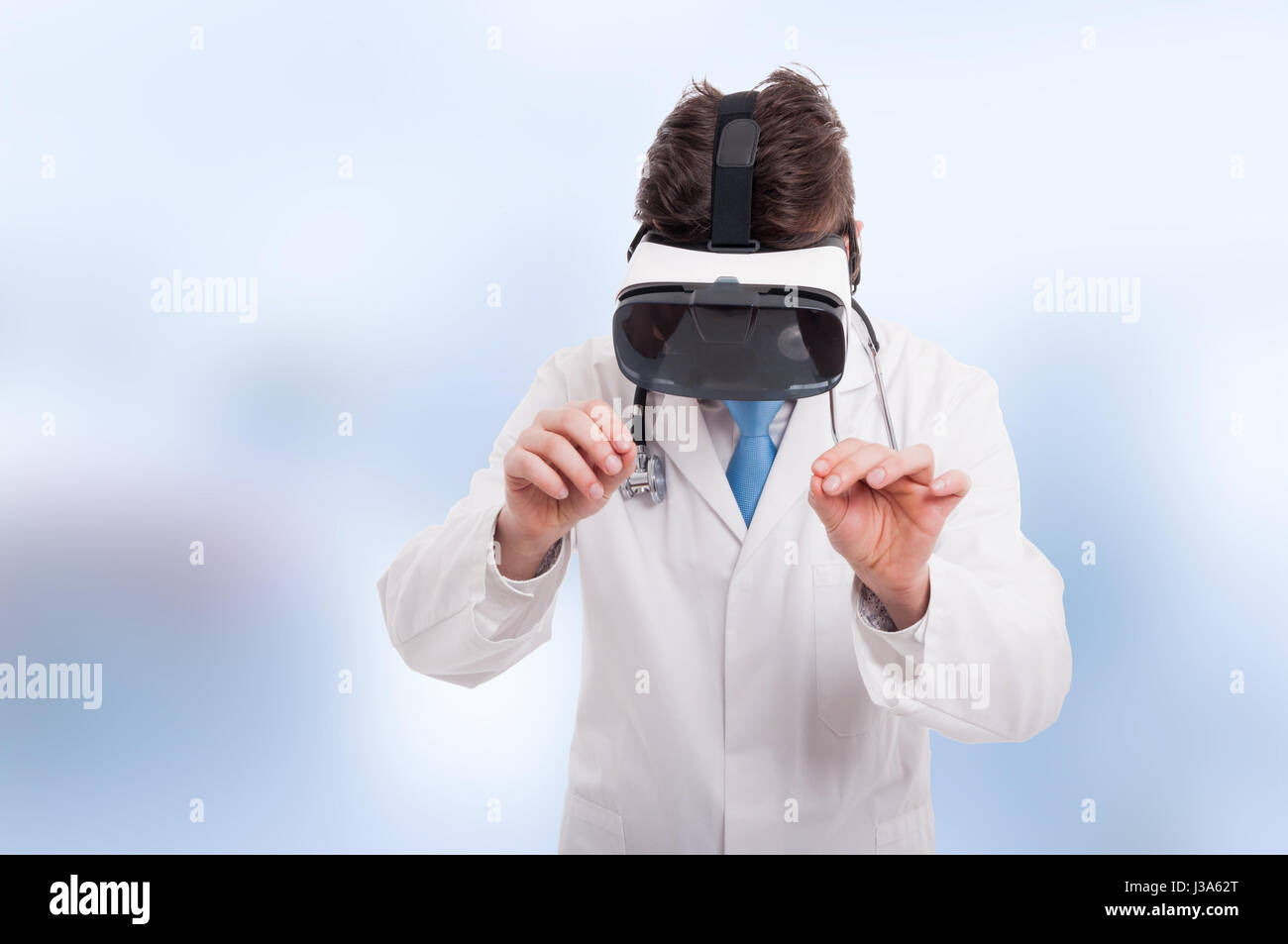 Medic using VR gadget to learn new things or  methods of surgery - Stock Image