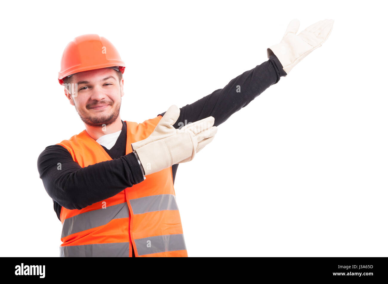 Architect with helmet showing something upwards isolated on white studio background - Stock Image