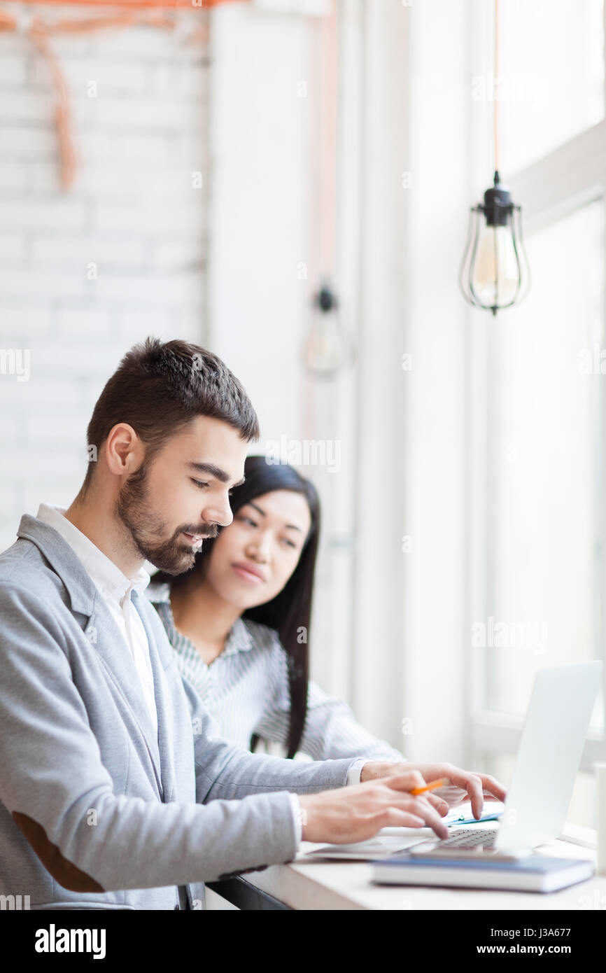 Brainstorming on Joint Project in Coffeehouse - Stock Image
