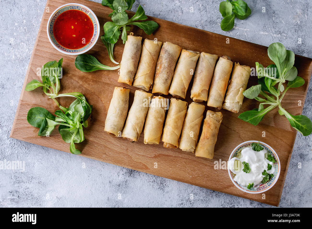 Fried spring rolls with sauce - Stock Image