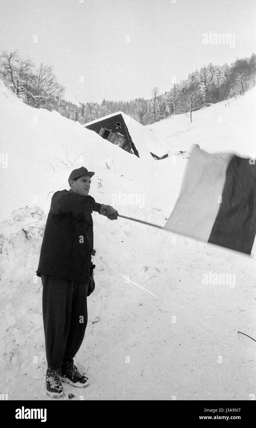 Helper in Blons giving signals with a signal flag, 1954 - Stock Image
