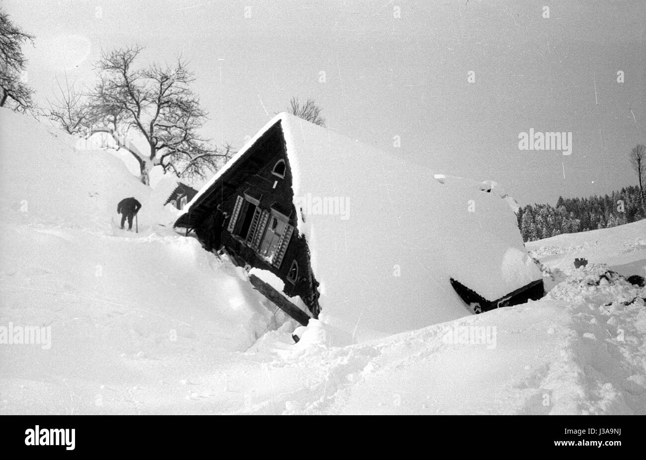 Buried houses after the avalanches in Blons, 1954 - Stock Image