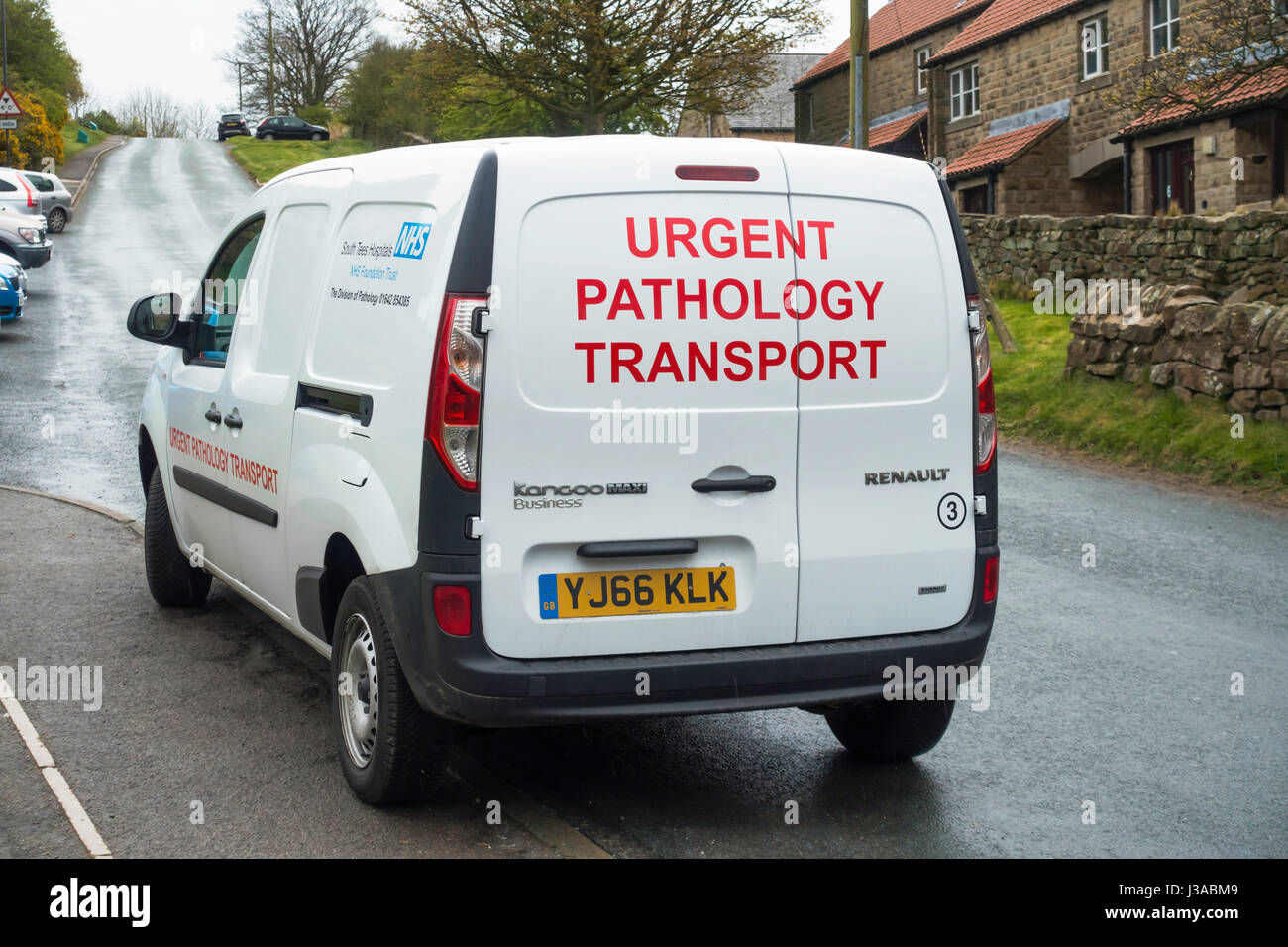 A small white National Health Service Van marked Urgent Pathology Transport in an English country village Stock Photo