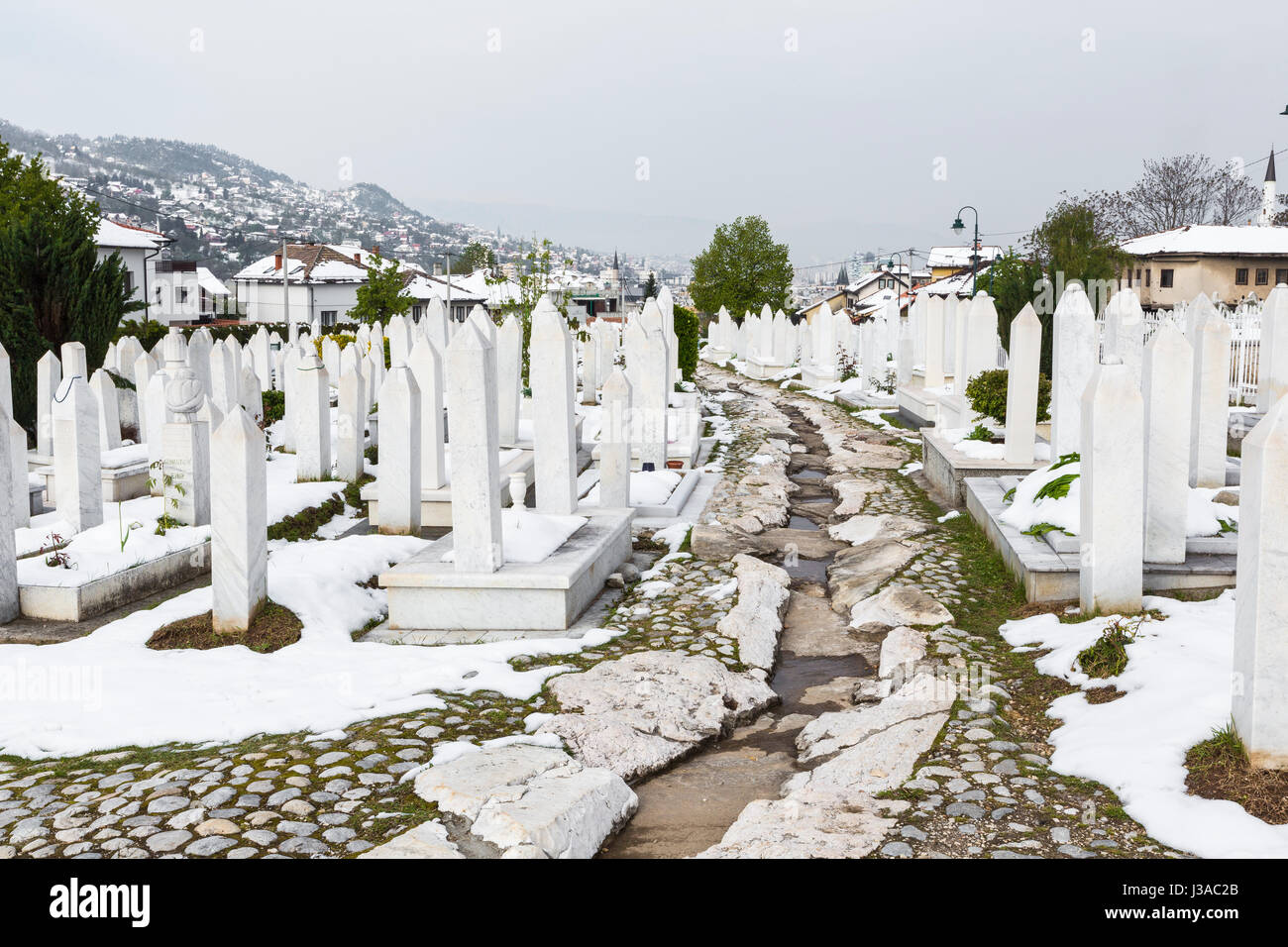 A muslim cemetery in a beautiful winter day in Sarajevo, Bosnia and Herzegovina. - Stock Image