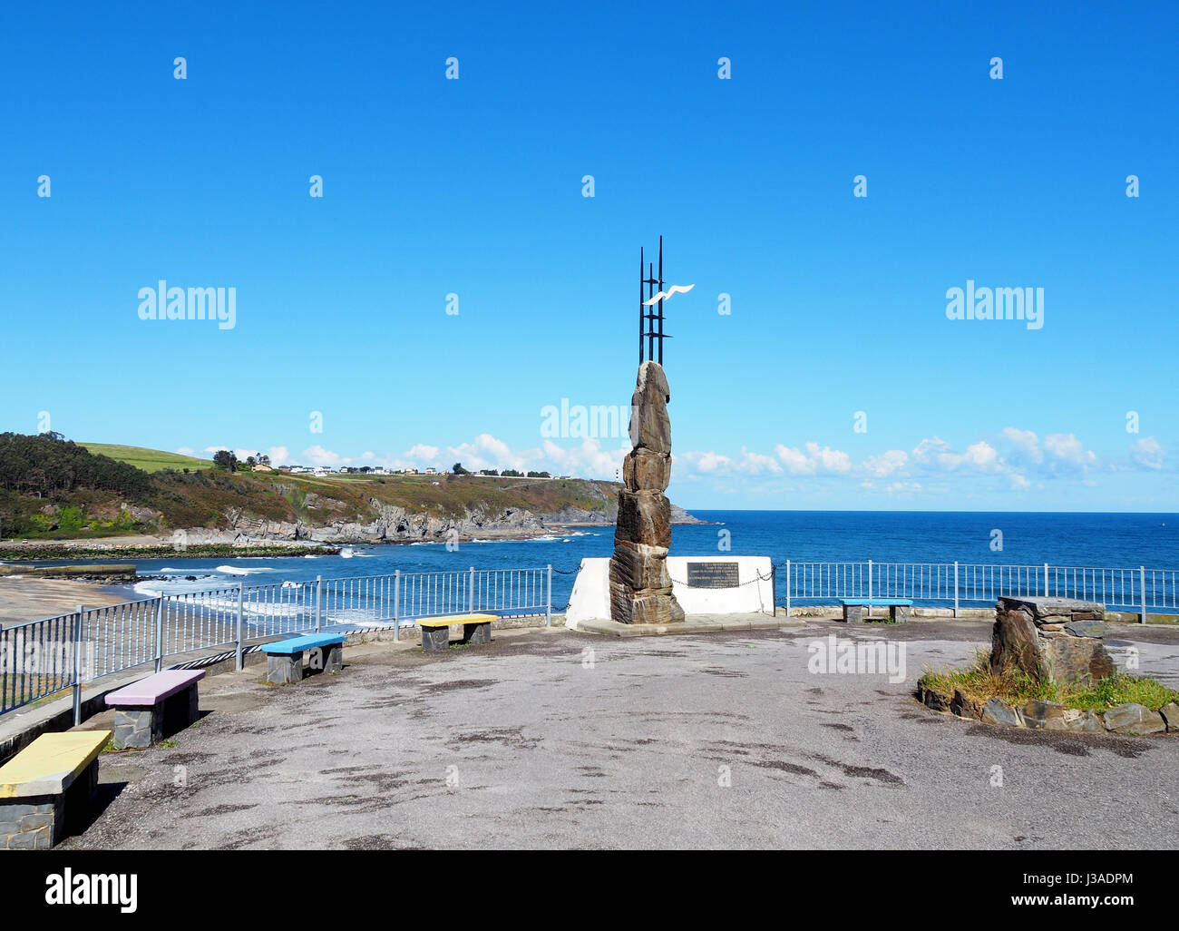 Emigrant monument in Navia, Spain. It is located in the viewpoint of the beach of Navia and is a tribute to the - Stock Image