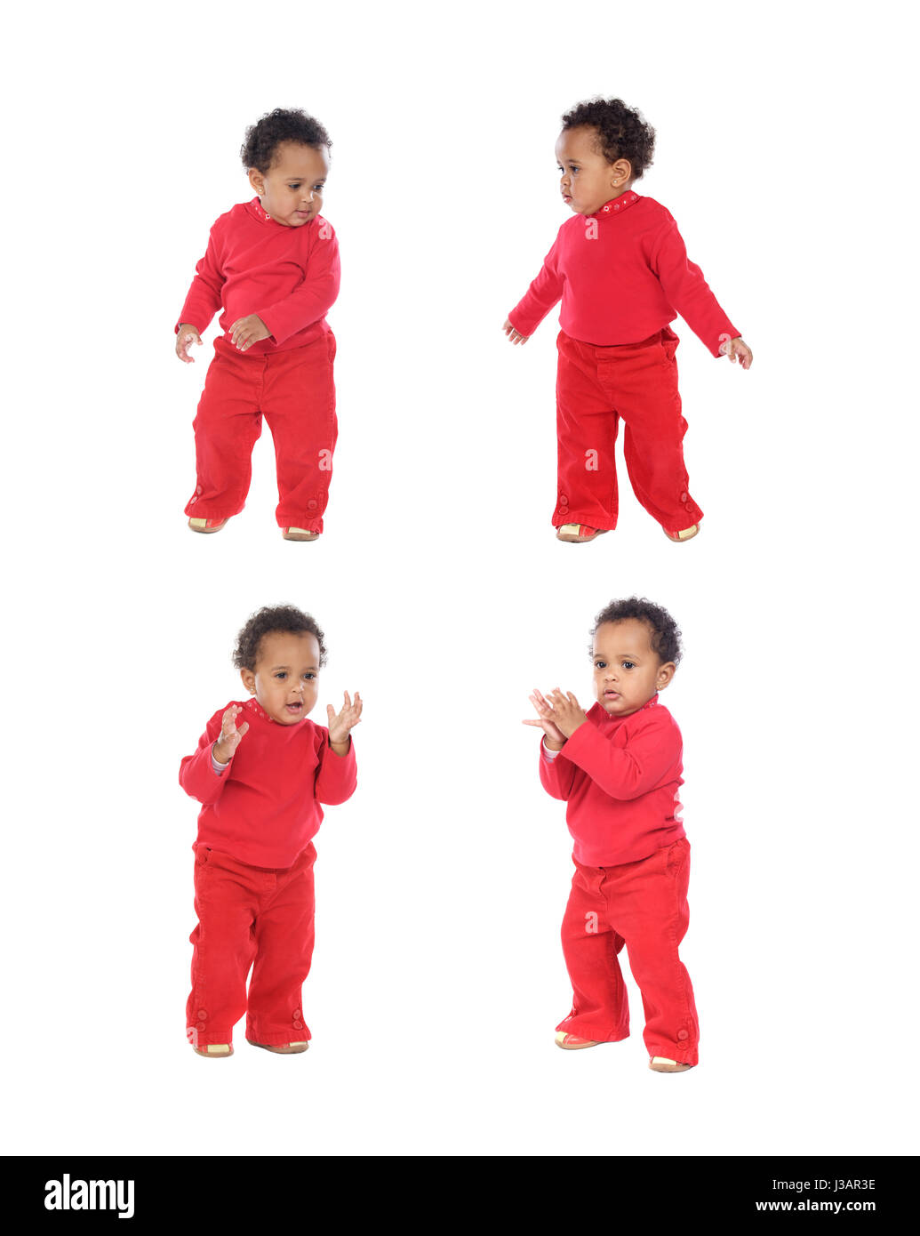 Four equal baby girls in red isolated on a white background - Stock Image