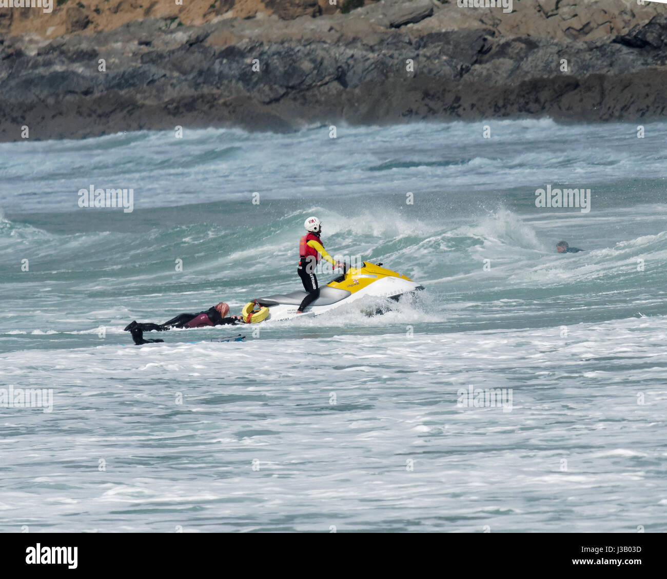 Newquay, UK. 4th May, 2017. Rescue at sea by Lifeguards. 4th, May, 2017. A man and woman on surfboards are rescued - Stock Image