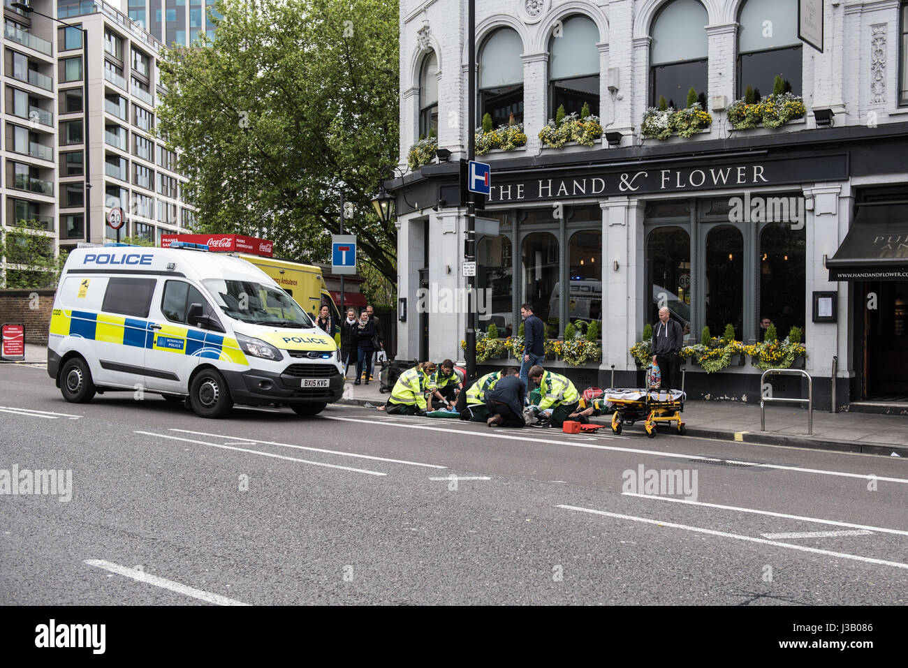London, UK. 4th May 2017. Two people were injured when a motorbike crashed onto the pavement. Several ambulance - Stock Image