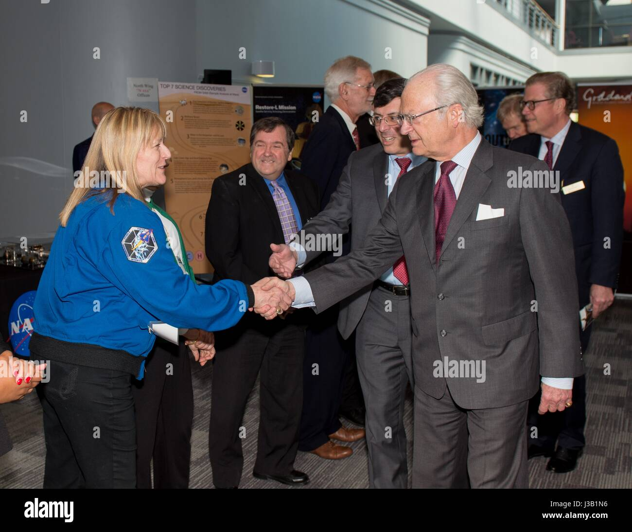 His Majesty The King of Sweden King Carl XVI Gustaf, right, is welcomed by NASA astronaut Kay Hire during a visit - Stock Image