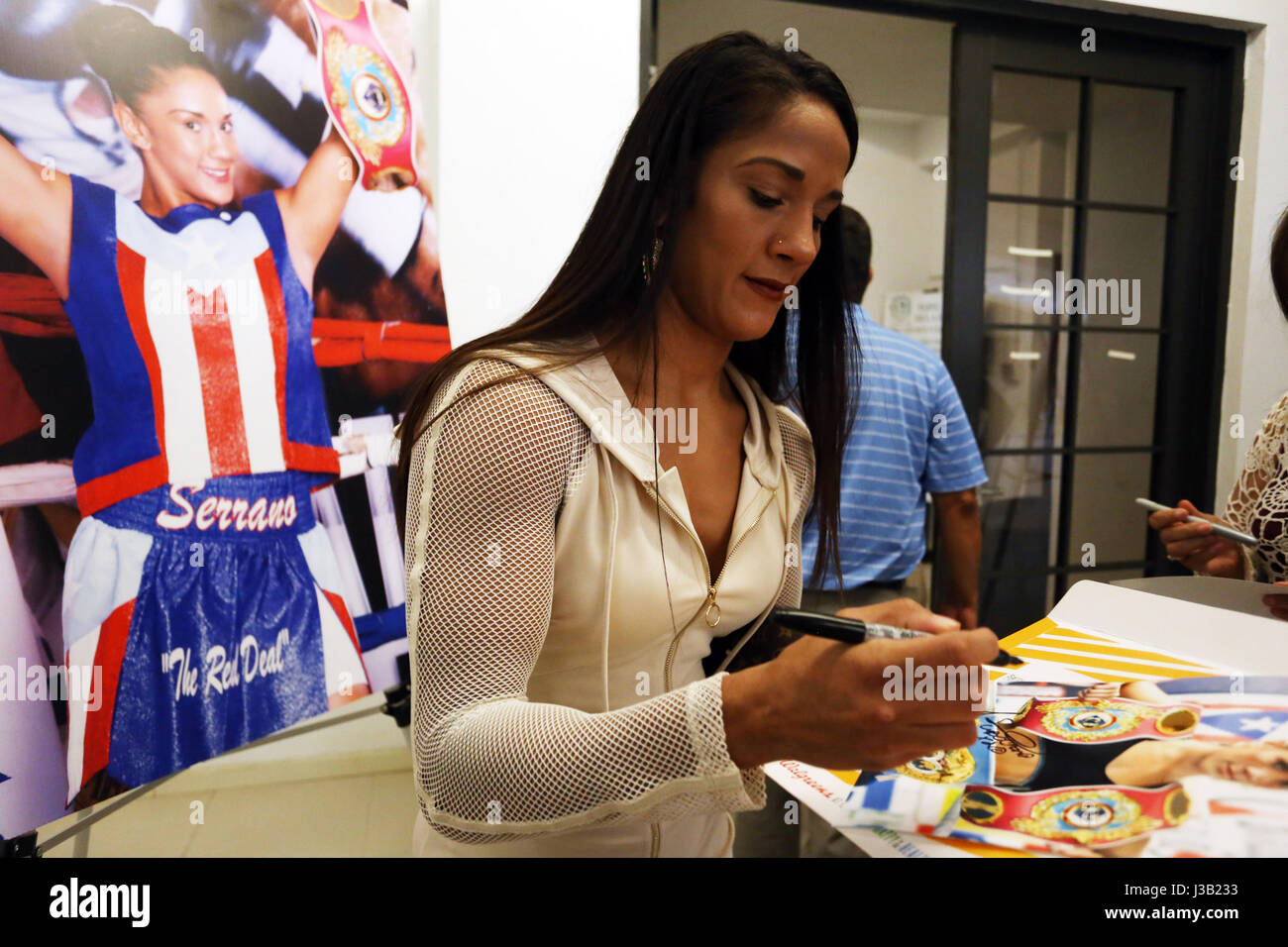 Puerto Rican boxer Amanda Serrano signs autographs after winning her belt and ring from the rooster weight division - Stock Image
