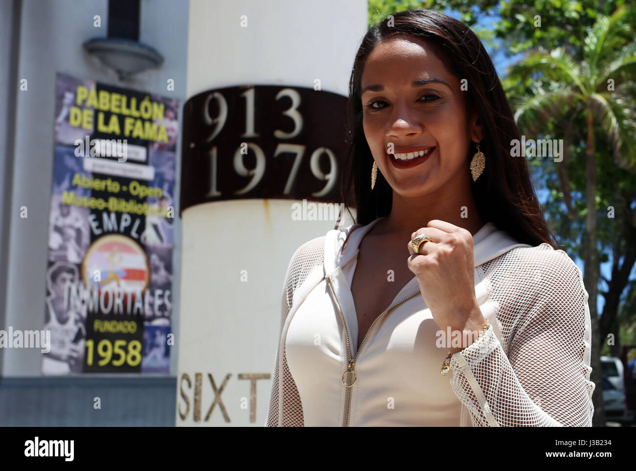 Puerto Rican boxer Amanda Serrano poses with her ring from the rooster weight division of the World Boxing Organization - Stock Image