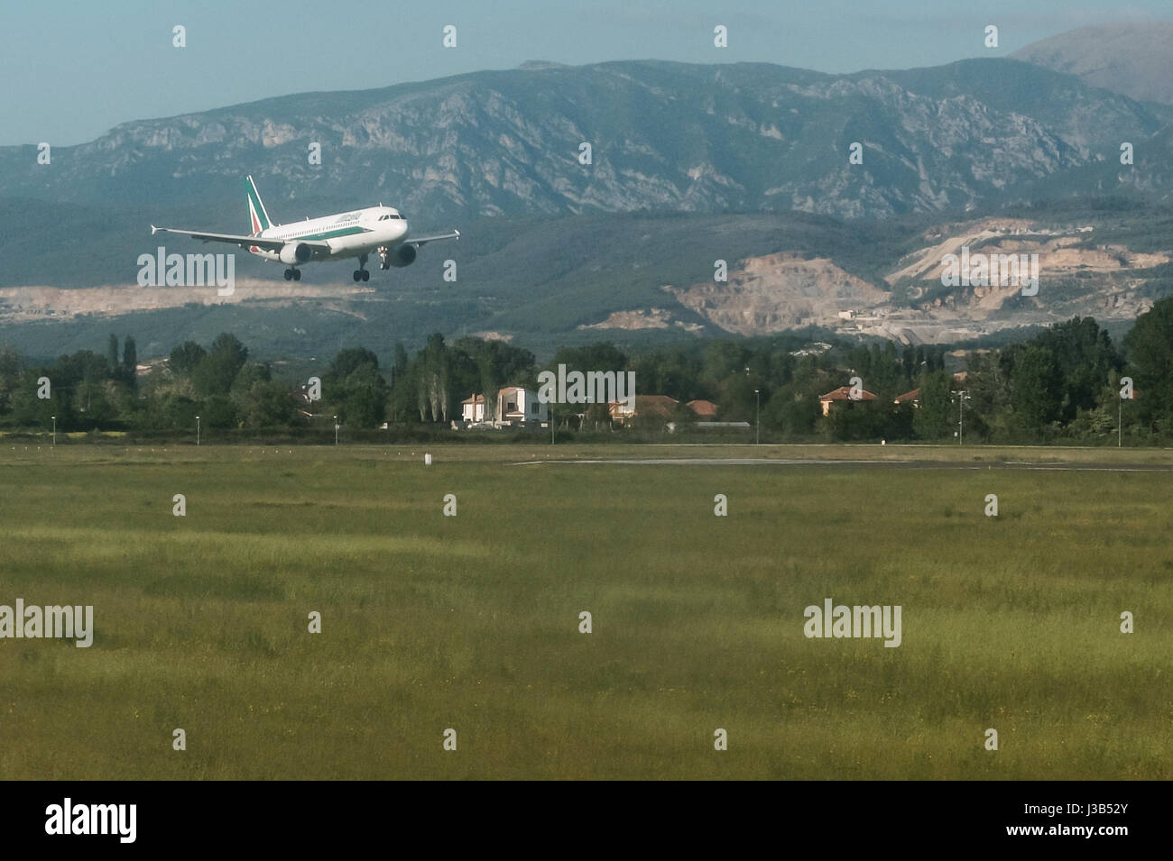 Tirane, Albania. 4th May, 2017. An Alitalia jet approaches for landing at Tirana International Airport in Albania. - Stock Image