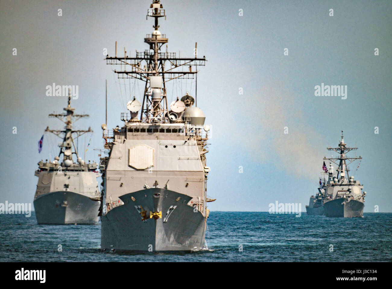 The U.S. Navy Ticonderoga-class guided-missile cruiser USS Lake Champlain, center, Korean Navy destroyers Sejong Stock Photo
