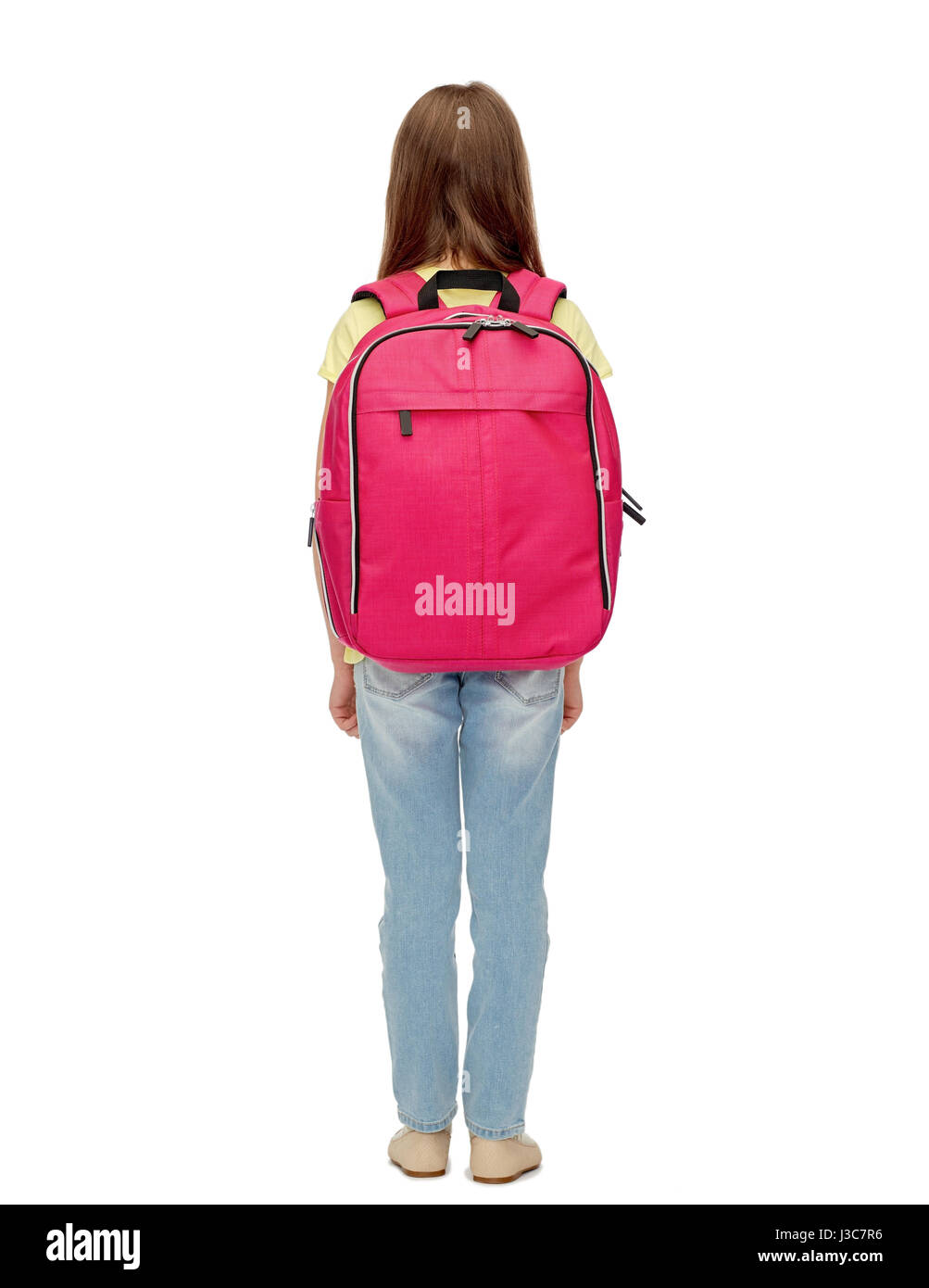 little student girl with school bag from back - Stock Image