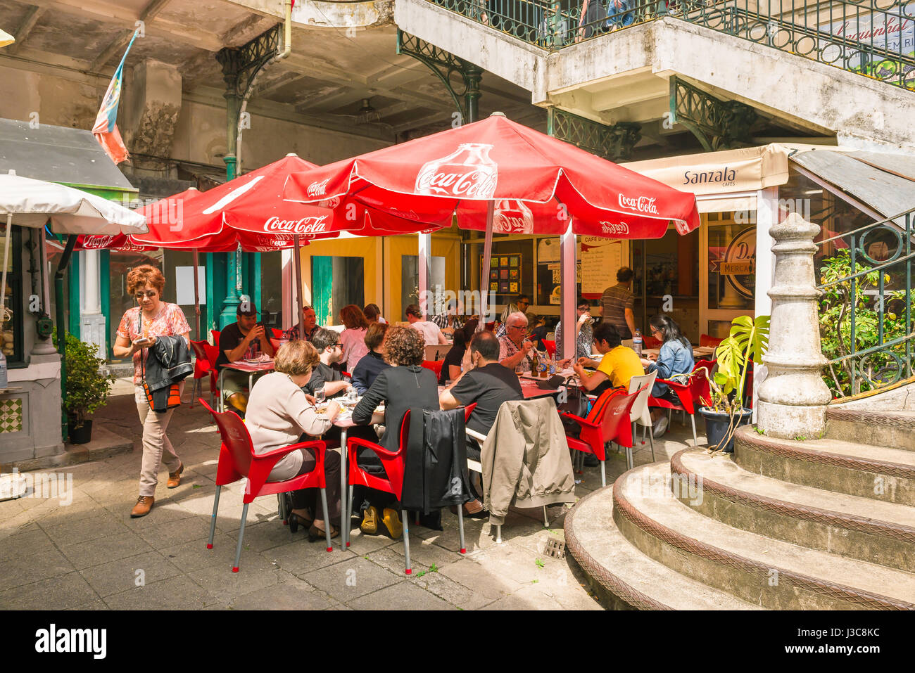 Bolhao Market Porto Portugal, visitors to the famous Mercado do Bolhao in Porto take lunch in one of the many al - Stock Image