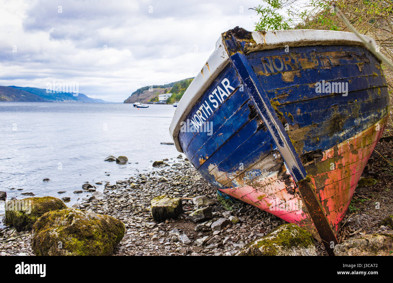 North Star old fallen to bits boat on Loch Ness shore - Stock Image