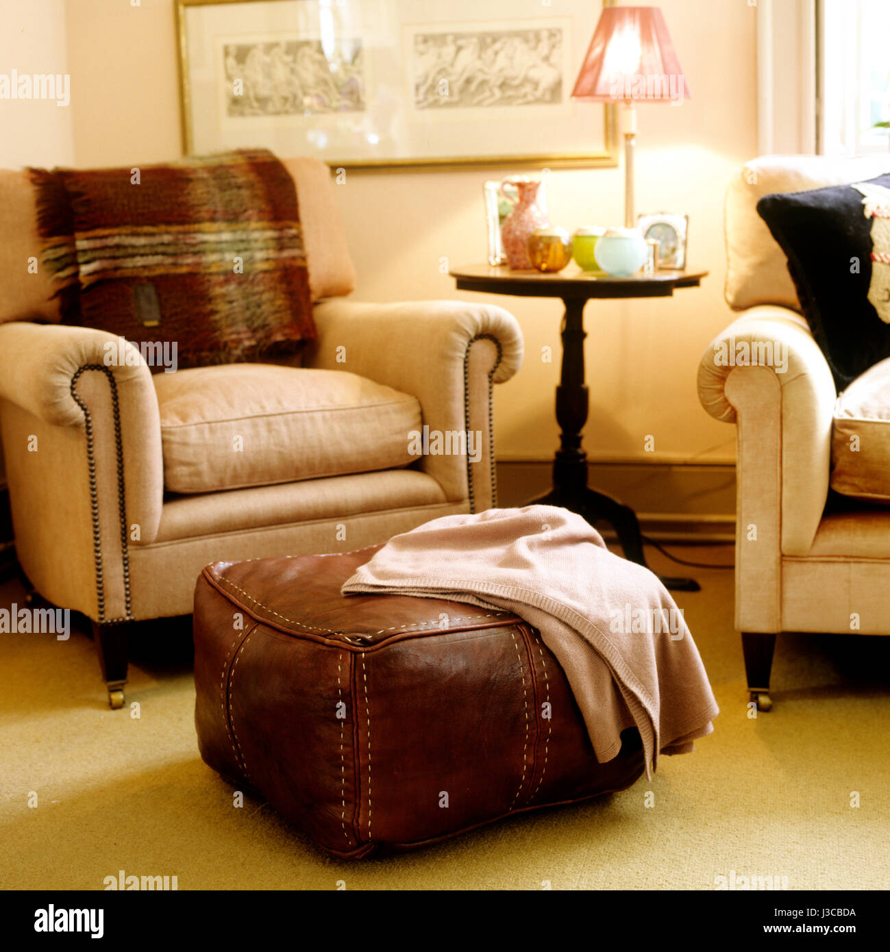 Cashmere Blanket On Leather Floor Cushion In Sitting Room With