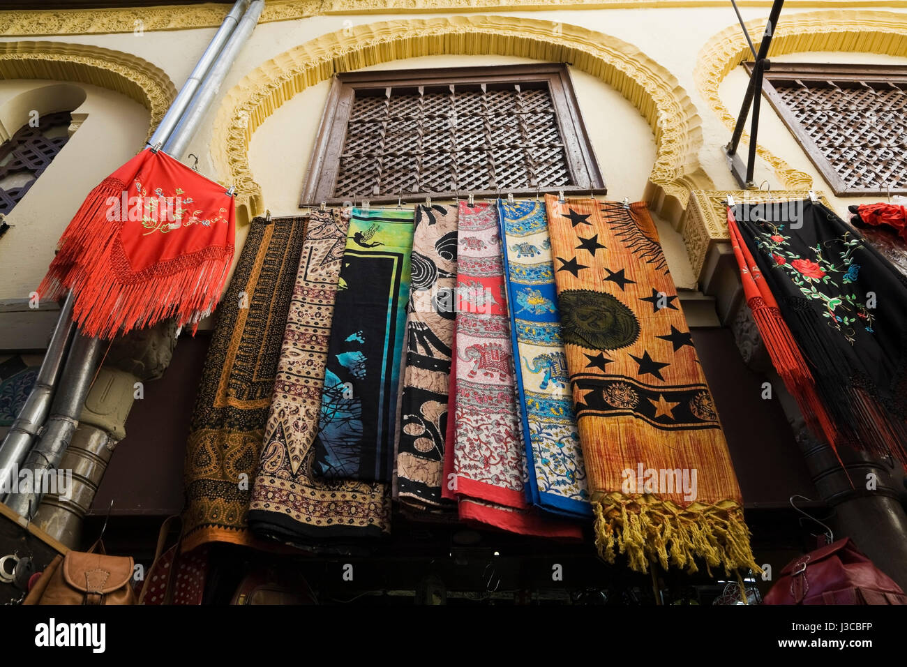 Hanging tablecloths at boutique at an Arab souk in Granada, Spain, Europe. - Stock Image