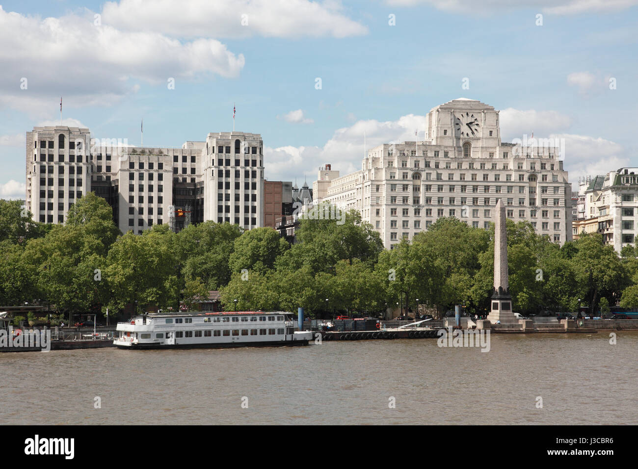 The Adelphi Hotel, the Shell Mex building and Cleopatra's Needle on the Victoria Embankment of the river Thames, - Stock Image