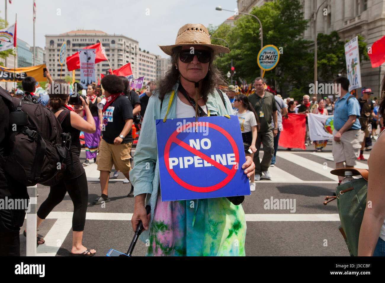 2017 People's Climate March (woman holding 'No Pipeline' sign, referring to Keystone XL pipeline) - - Stock Image