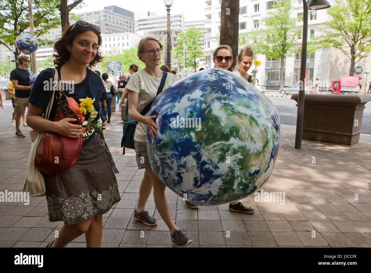 2017 People's Climate March (woman holding an blue earth balloon) - Washington, DC USA - Stock Image