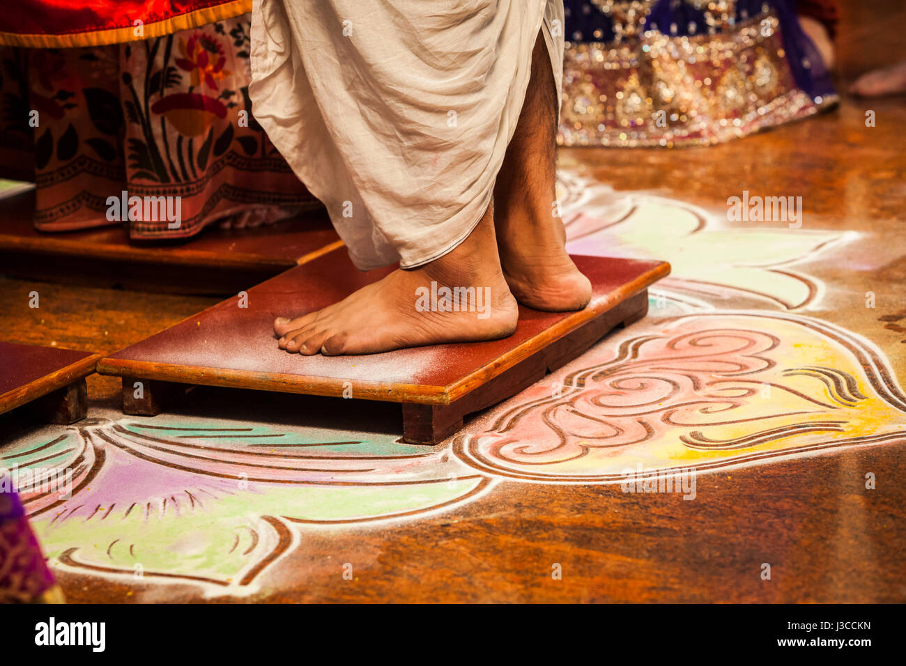 A man's bare feet during his wedding, Pune, India. - Stock Image