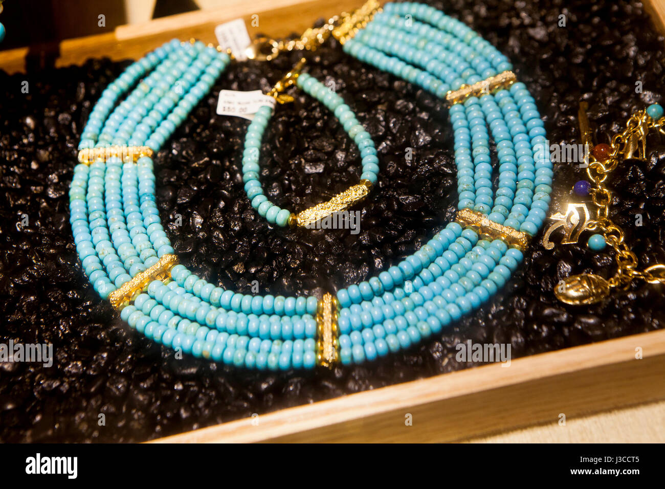 Turquoise necklace on display at jewelry store - USA - Stock Image
