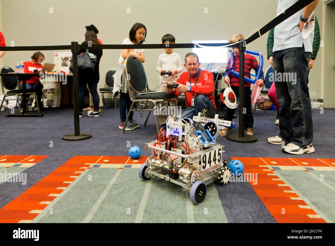 Children watching robotics demonstration during STEM festival - USA - Stock Image