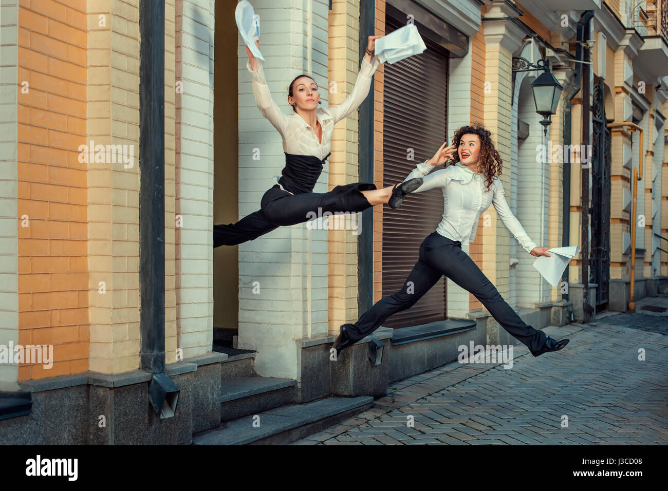 Girls happily run out of office in signing the contract. - Stock Image