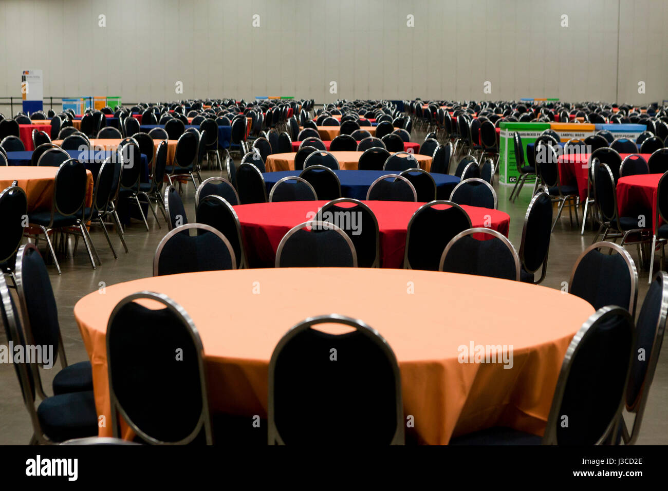 Tables and chairs setup for large indoor event - USA - Stock Image