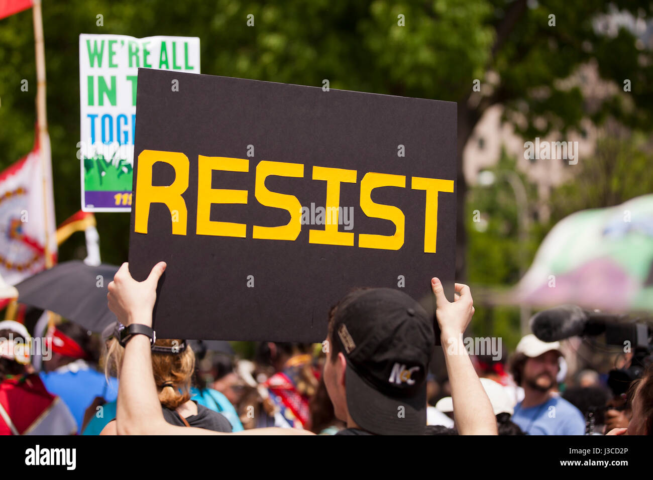 Resist sign at Anti Trump protest rally - USA - Stock Image