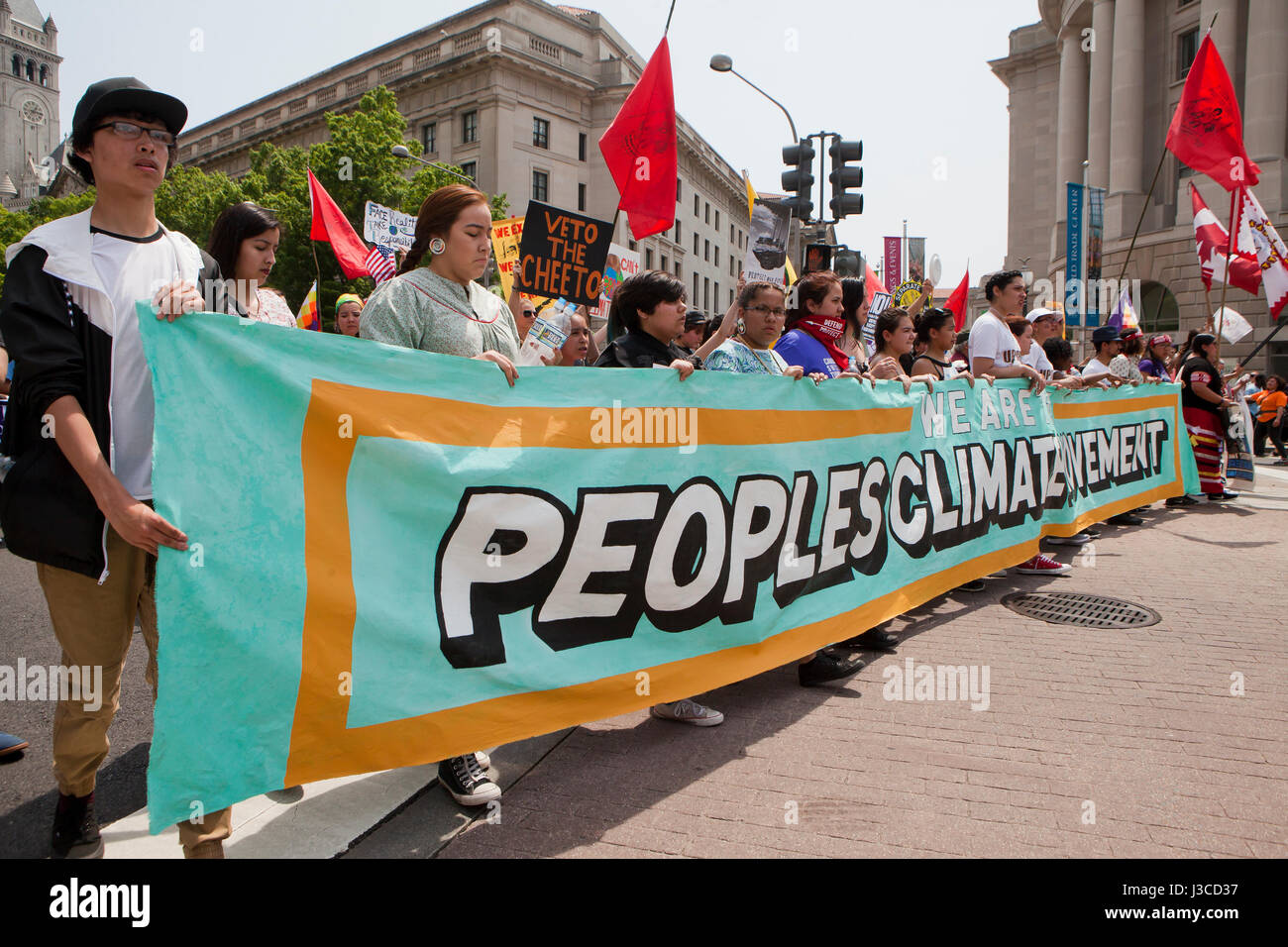 2017 People's Climate March (protesters marching with Peoples Climate Movement banner) - Washington, DC USA - Stock Image