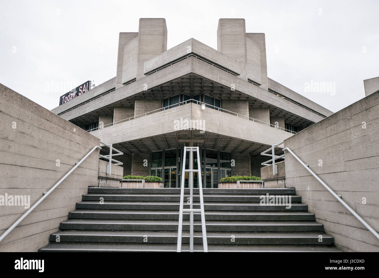 The National Theatre of Great Britain at the Southbank Centre, London. Designed by Denys Lasdun, the building is - Stock Image